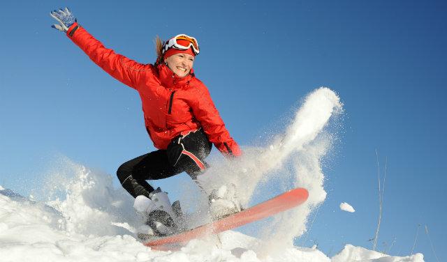 Lady snowboarding